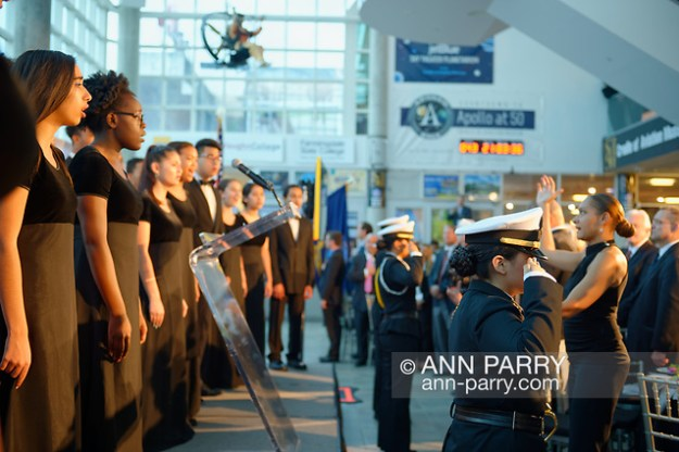Garden City, NY, U.S. June 6, 2019. Freeport High School Select Chorale singers perform - with their Director MONIQUE RETZLAFF standing at right, facing them - during Apollo at 50 Anniversary Dinner. FHS Navy Junior ROTC cadets are saluting. Apollo astronaut tribute celebrating the Apollo 11 mission Moon landing was held at Cradle of Aviation Museum. ( 2019 Ann Parry/Ann-Parry.com)