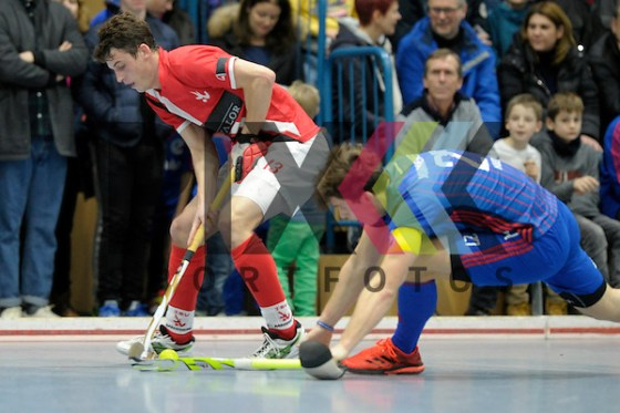GER - Mannheim, Germany, January 15: During the men hockey match between Mannheimer HC (blue) and TSV Mannheim (red) on January 15, 2017 at Irma-Roechling Halle in Mannheim, Germany. Final score 8-6 (HT 1-2).  Nils Gruenewald #13 of TSV Mannheim, Timm Haase #27 of Mannheimer HC Foto © PIX-Sportfotos *** Foto ist honorarpflichtig! *** Auf Anfrage in hoeherer Qualitaet/Aufloesung. Belegexemplar erbeten. Veroeffentlichung ausschliesslich fuer journalistisch-publizistische Zwecke. For editorial use only. (PIX-Sportfotos /Dirk Markgraf)