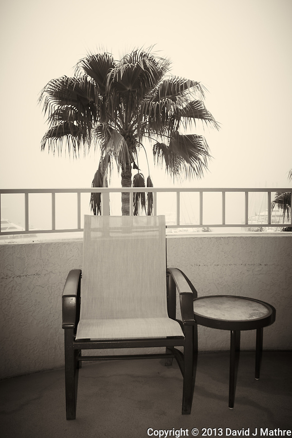Lonely chair on the balcony in the Early Morning Fog. Image taken at the Vinoy Hotel in St. Petersburg with a Nikon 1 V1 camera and 10 mm f/2.8 lens (ISO 100, 10 mm, f/4.5, 1/250 sec). Raw image processed with Capture One 7 Pro (including conversion to B&W). (David J Mathre)