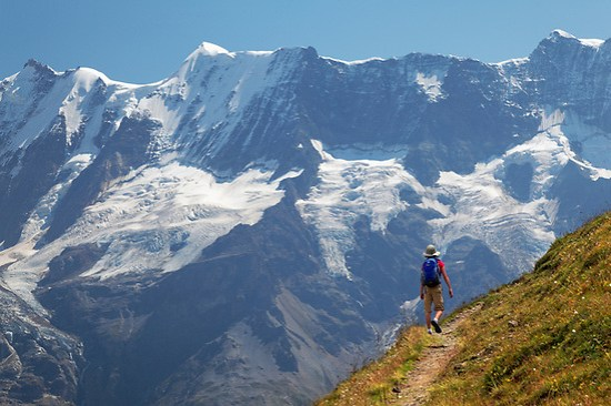 Girl hiking trail on trail from Grauseeli to Wasenegg ridge on Schilthorn mountain with the Lauterbrunnen Wall in background, Switzerland (Brad Mitchell)