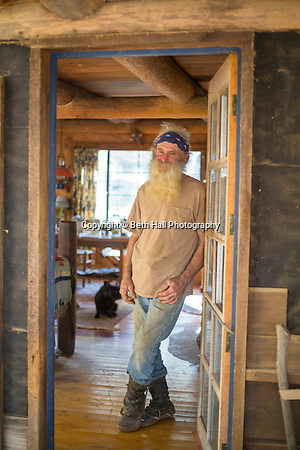 Robert Runyon stands in the doorway of his home in Sugar Tree Hollow in Winslow, Arkansas, for Out Here Magazine. Photo by Beth Hall (Beth Hall)