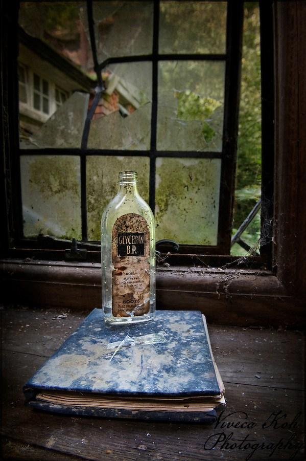 Empty glycerin bottle on book (Viveca Koh)