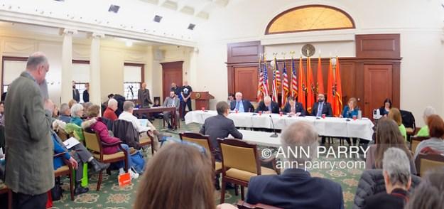 Mineola, NY, USA. 15th Feb, 2019. Invited speaker addresses (L-R, at table) NYS Senator JOHN BROOKS, Assemblyman STEVE ENGLEBRIGHT, NYS Sen. TODD KAMINSKY, NYS Sen, KEVIN THOMAS, and Assemblywoman JUDY GRIFFIN, during NYS Senate Public Hearing on Climate, Community & Protection Act, Bill S7253, sponsored by Sen. Kaminsky. (© 2019 Ann Parry/Ann-Parry.com)