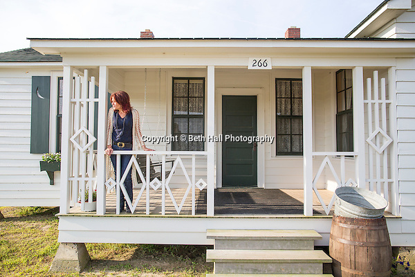 Rosanne Cash stands on the front porch of her father Johnny Cash's boyhood home on Saturday, August 16, 2014, in Dyess, Ark. The home was restored to it's appearance when the Cash family lived in it, from 1935-1954, and was part of The Dyess Colony that was created in 1934 as part of President Franklin D. Roosevelt's New Deal. Photo by Beth Hall (Beth Hall)