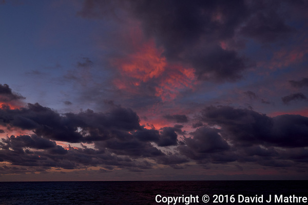 Colorful Dawn clouds over the Pacific Ocean from the deck of the MV World Odyssey. Image 6 of 6 taken with a Fuji X-T1 camera and 23 mm f/1.4 lens (ISO 200, 23 mm, f/5.6, 1/60 sec). Raw images processed with Capture One Pro. (David J Mathre)
