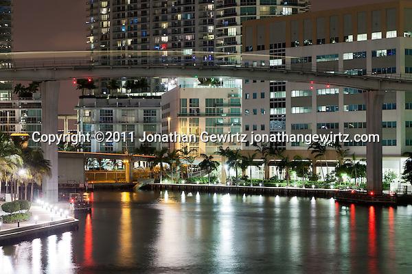 A Miami Metromover automated train car crosses the Miami River at night. (Jonathan Gewirtz)