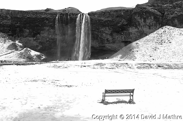 Lonely Observation Bench in the Snow at Seljalandsfoss, a Waterfall in Southern Iceland. Image taken with a Leica X2 camera (ISO 100, 24 mm, f/5.6, 1/125 sec). (David J Mathre)