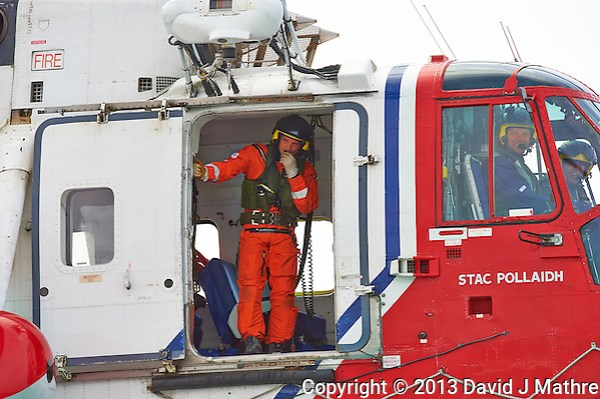 Netherlands Coast Guard Rescue Helicopter (G-BIMU, Stac Pollaidh) Hovering Near the Semester at Sea M/V Explorer in the North Sea. Image taken with a Nikon D4 and 80-400 mm VRII lens (ISO 800, 400 mm, f/13, 1/640 sec). (David J Mathre)