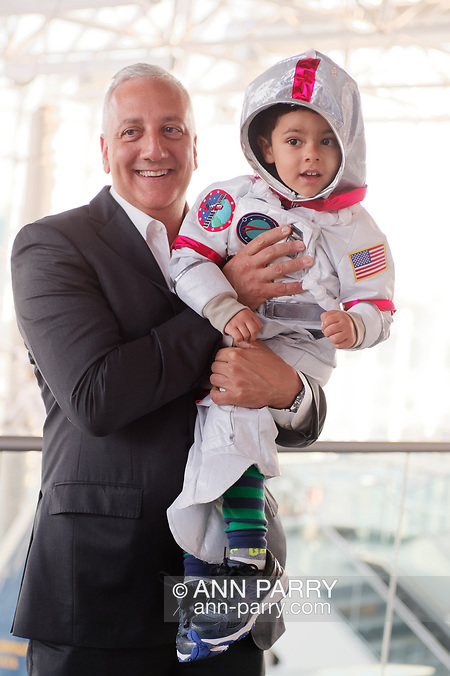 Garden City, NY, USA. June 21, 2018. Space Shuttle Astronaut MIKE MASSIMINO is holding GIOVANNI, 3 1/2 years old, from Manhasset, wearing an astronaut's space suit costume, after the museum's Members Meet & Greet. (© 2018 Ann Parry/Ann-Parry.com)