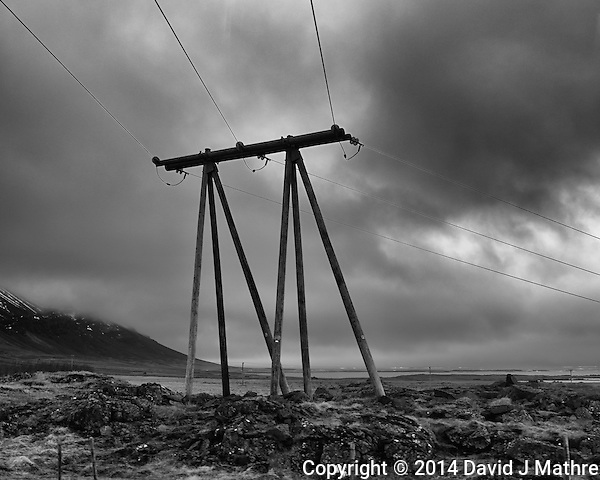 Twin-Tripods. Powerlines from a Bus on a Winter Day in Iceland. Image taken with a Leica X2 camera (ISO 100, 24 mm, f/4.5, 1/250 sec). Raw image processed with Capture One Pro and Google Silver Efex Pro. (David J Mathre)