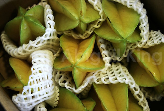 Starfruit in Okinawa, Japan, wrapped in white mesh and for sale in a market. (Abigail King)