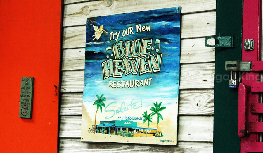 Vibrant painted sign for the Blue Heaven Restaurant