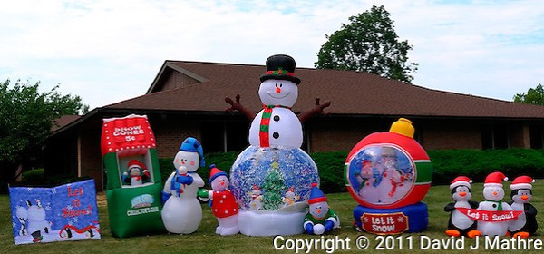 Let it Snow -- July and 98°F in New Jersey. Wishful Thinking Inflatable Display in Front of the Carrier Clinic in Belle Mead, NJ. Image taken with a Leica X1 camera (ISO 100, 24 mm, f/5.6, 1/400 sec). Out of the camera jpg image. (David J. Mathre)