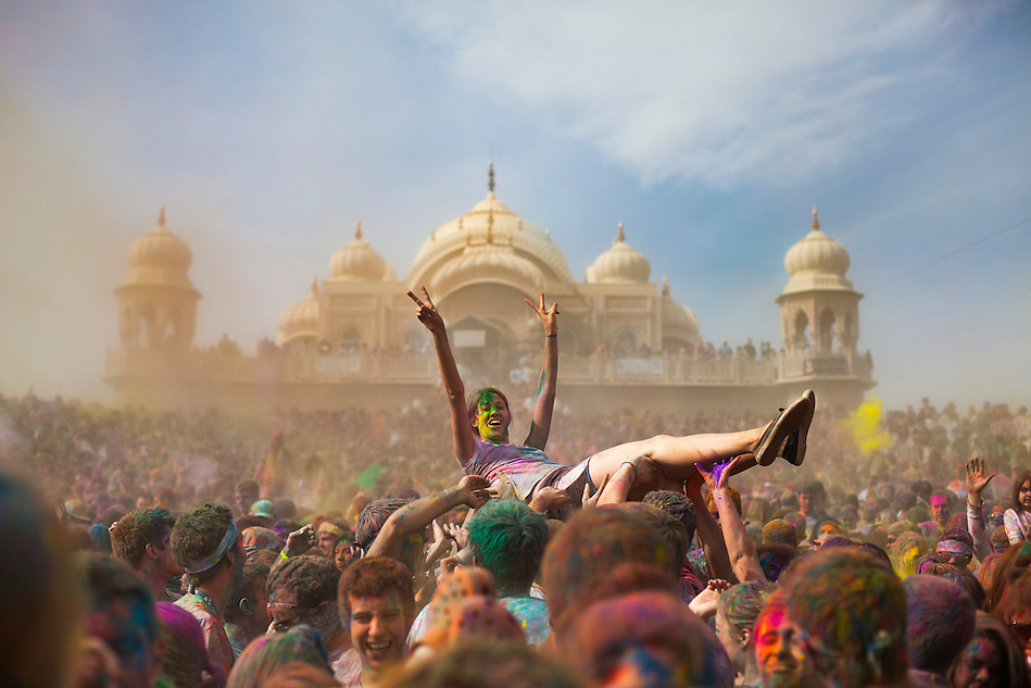 A female crowd surfs in front of the Lotus Temple, in Spanish Fork, Utah, during the Holi Festival of Colors, on Saturday, Mar. 24, 2012, at (Photo by Benjamin B. Morris ©2012) (Benjamin B. Morris)