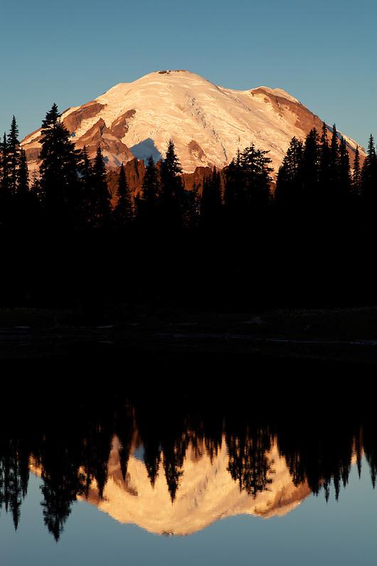 Mount Rainier reflected in Tipsoo Lake during a calm sunrise, Mount Rainier National Park, Washington