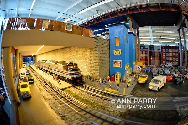 Farmingdale, New York, USA. November 26, 2016. An Amtrak model train speeds through a tunnel at the Train Masters of Babylon TMB Model Train Club's Open House. Visitors enjoy a 4000 square foot O Gauge model railroad with 10 trains running on 19 scale miles of track and an underground subway system. Watching O Scale model trains traveling on tracks through various elaborate scenes was family fun, free and open to the public, during the long Thanksgiving holiday weekend. (Ann Parry/Ann Parry, ann-parry.com)