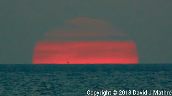 Sunset on the Baltic Sea. Are There Offshore Oil Platforms in the Baltic Sea Off Denmark? Image taken with a Nikon 1 V2 camera FT1 adapter and 80-400 mm VRII lens (ISO 400, 400 mm, f/5.6, 1/500 sec). Semester at Sea Spring 2013 Enrichment Voyage. (David J Mathre)