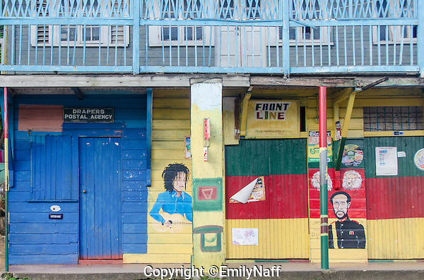 Color building in Drapers, Jamaica houses the Post Office a small store and a bar. (Emily Naff)