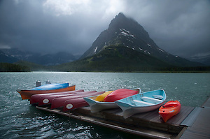 Boats on Many Glacier Lodge Dock at Swiftcurrent Lake under Grinnell Peak and Storm Clouds, Glacier National Park, Montana, US (Roddy Scheer)