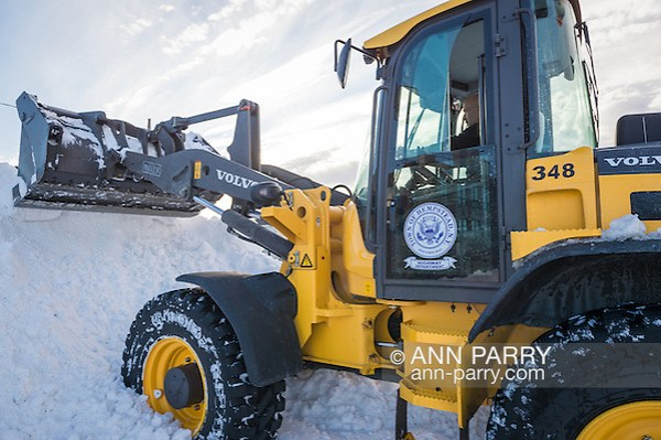Merrick, New York, USA. January 24, 2016. After Nor'easter drops more than two feet of snow on south shore of Nassau County, Long Island, many Town of Hempstead Highway Department employees work long hours operating snow ploys to plows to remove about 25 inches of snow blanketing downtown streets and public parking lots. (Ann Parry/Ann Parry, ann-parry.com)