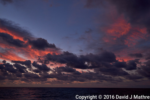 Colorful Dawn clouds over the Pacific Ocean from the deck of the MV World Odyssey. Image 5 of 6 taken with a Fuji X-T1 camera and 23 mm f/1.4 lens (ISO 200, 23 mm, f/5.6, 1/60 sec). Raw images processed with Capture One Pro. (David J Mathre)