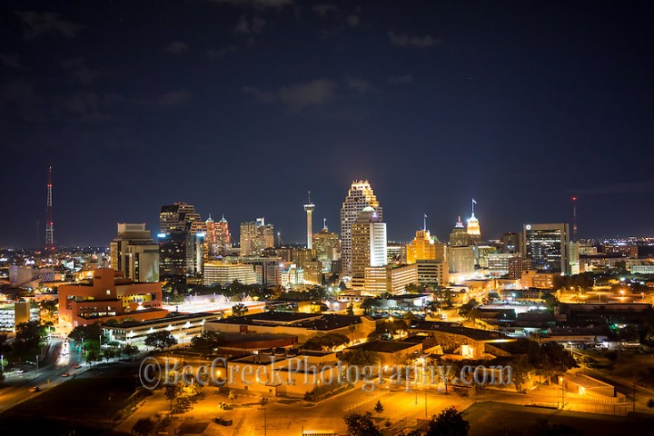 This is an image of the San Antonio skyline at night in downtown.  You can see the Tower of Americas, the Tower Life building, along with many hotels such as the Marriott, the Grand Hyatt, Weston, Drury, Hilton that run along the river walk to name a few of the taller hotels in the city. (Tod Grubbs & Cynthia Hestand)