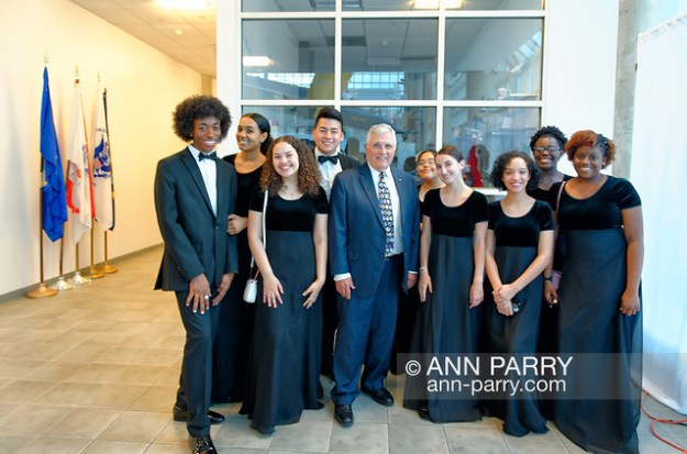 Garden City, New York, USA. June 6, 2019. Apollo 17 astronaut HARRISON SCHMITT, at center, poses with Freeport High School Select Chorale members soon to perform at Apollo at 50 Anniversary Dinner at Cradle of Aviation Museum. (Ann Parry/Ann Parry, ann-parry.com)