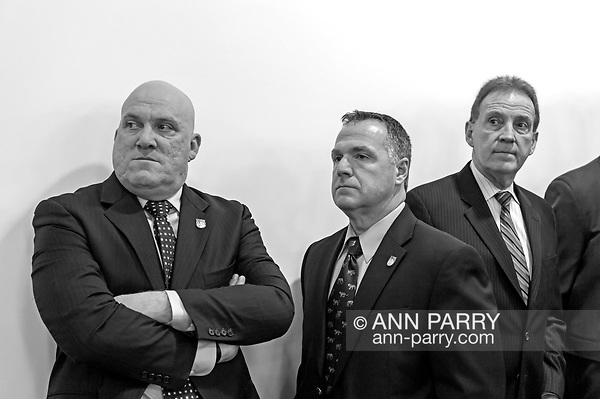 Mineola, NY, USA. March 5, 2012.L-R, Nassau PBA President JAMES CARVER, PBA's Sergeant-at-arms JAMES McDERMOTT, and President of Superior Officers (SOA) GARY LEARNED attend Nassau County Legislature meeting when legislators vote to confirm Thomas Dale as Police Commissioner and to consolidate 8 police precincts into four. (© 2012 Ann Parry/Ann-Parry.com)
