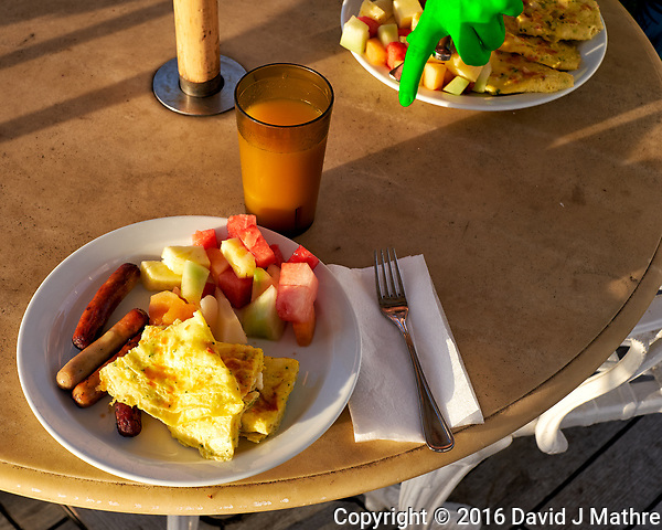 Outdoor breakfast after shooting dawn and sunrise on the deck of the MV World Odyssey. Image taken with a Fuji X-T1 camera and 35 mm f/1.4 lens (ISO 200, 35 mm, f/7, 1/125 sec). (David J Mathre)