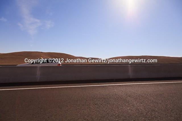 Barrent Judean hills are the backdrop for Highway 1 as it descends from Jerusalem to the Dead Sea. (© 2012 Jonathan Gewirtz / jonathan@gewirtz.net)
