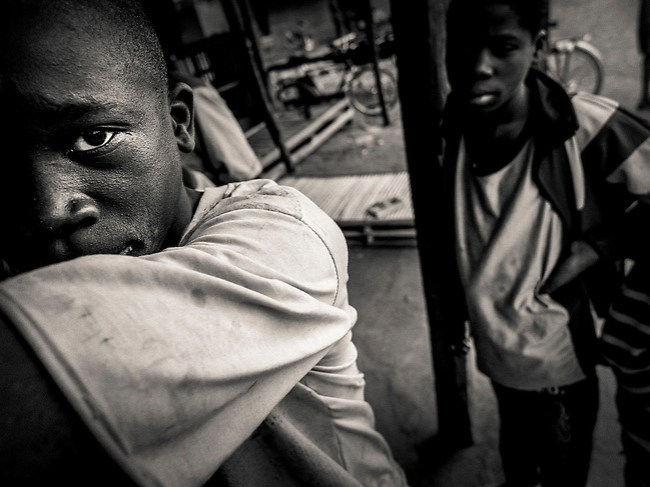 Africa, Mali, Siby, Travel, West Africa a boy waiting to play (Vittore Buzzi)