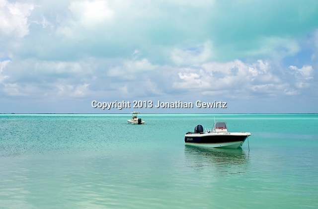 Small boats on green tropical waters under a partly cloudy blue sky (Jonathan.Gewirtz@gmail.com)