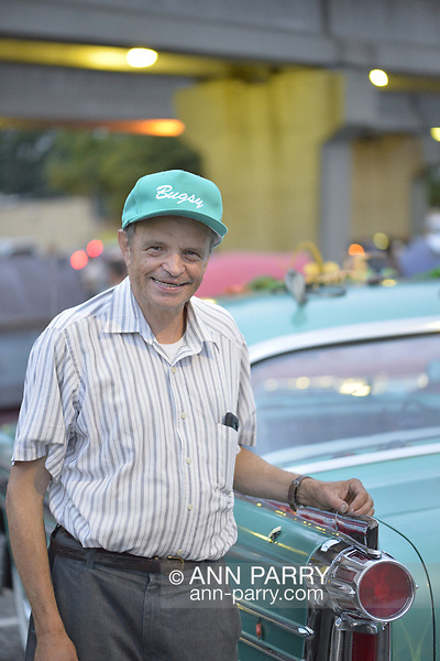 Bellmore, New York, USA. 11th August 2017. FRANK MARTOCCI, of Bellmore is owner of green Oldsmobile, 1958. (Ann Parry/Ann Parry, ann-parry.com)