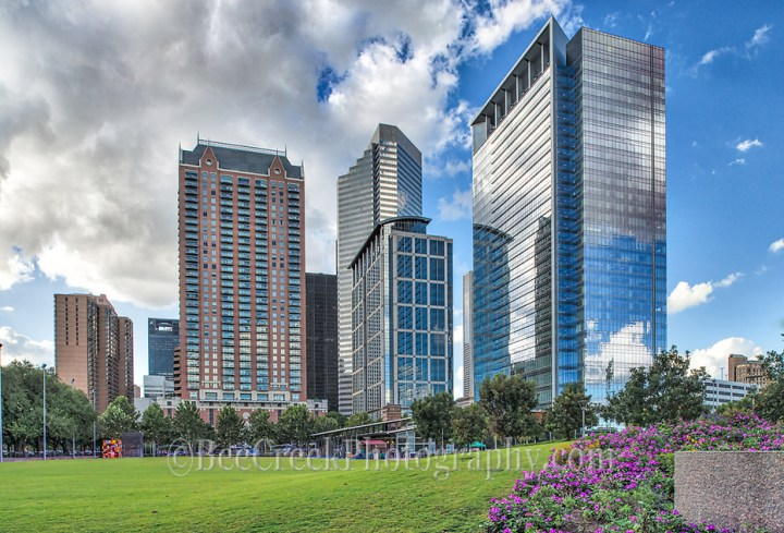 We capture this image as we came up to the discovery green park in Houston right across from the new George Brown Convention center and we thought it was pretty with the colorful flowers and the high-rises in the distance. (Bee Creek Photography - Tod Grubbs & Cynthia Hestand)