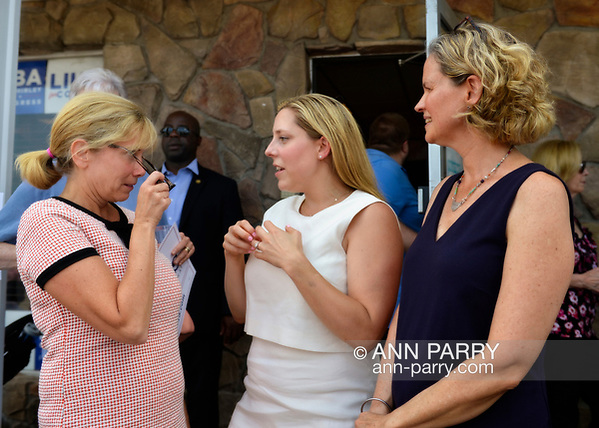Massapequa, NY, USA. August 5, 2018. L-R, Democrats Laura Gillen, Hempstead Town Supervisor; Liuba Grechen Shirley, Congressional candidate for NY 2nd District; and Laura Curran, Nassau County Executive, chat at campaign event. (© 2018 Ann Parry/Ann-Parry.com)