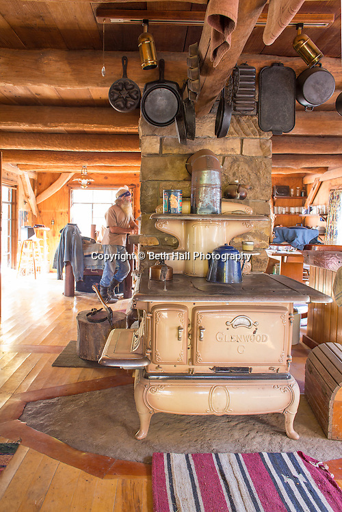 Interior looking from the kitchen to the living area of the home of Robert Runyon in Sugar Tree Hollow in Winslow, Arkansas, for Out Here Magazine. Photo by Beth Hall (Beth Hall)