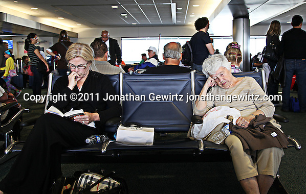 Passengers wait for a delayed flight at Fort Lauderdale Hollywood International Airport. (Jonathan Gewirtz)