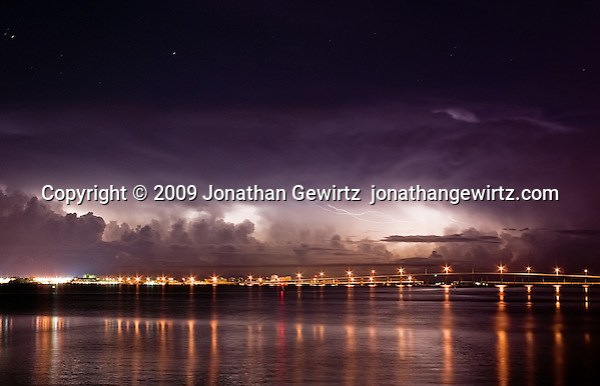 A dramatic pre-dawn thunderstorm over the Atlantic Ocean beyond Key Biscayne, as seen from the Brickell Key causeway in Miami. (© Jonathan Gewirtz, jonathan@gewirtz.net)