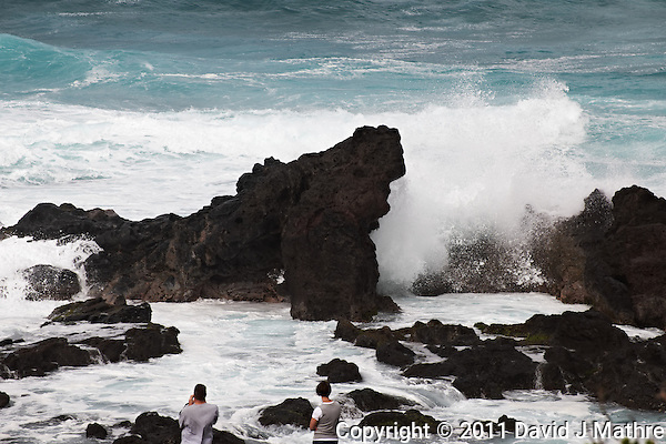 Tourists watching waves crashing over volcanic rocks at Hookipa Beach Park. From the beach overlook on the North Shore of Maui. Image taken with a Nikon D3x and 70-300 mm VR lens (ISO 100, 220 mm, f/9, 1/320 sec) (David J Mathre)