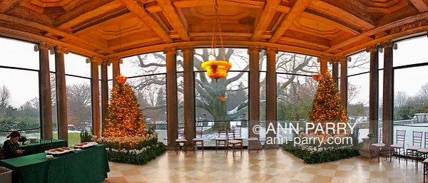 Old Westbury, New York, USA. December 17, 2017. At Westbury House, two Christmas trees flank the Porch facing West,with panoramic view of snowy grounds during Winter Holiday event at Old Westbury Gardens. (© 2017, Ann Parry/Ann-Parry.com)