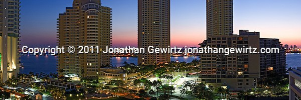 Panoramic view of residential condominium buildings on Miami's Brickell Key (Claughton Island) with the dawn sky, Port of Miami and Miami Beach in the background. (Jonathan Gewirtz)
