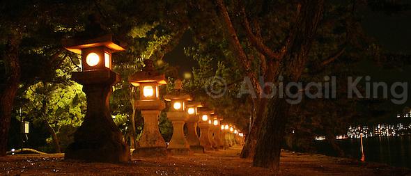 Row of stone lanterns on Miyajima Island