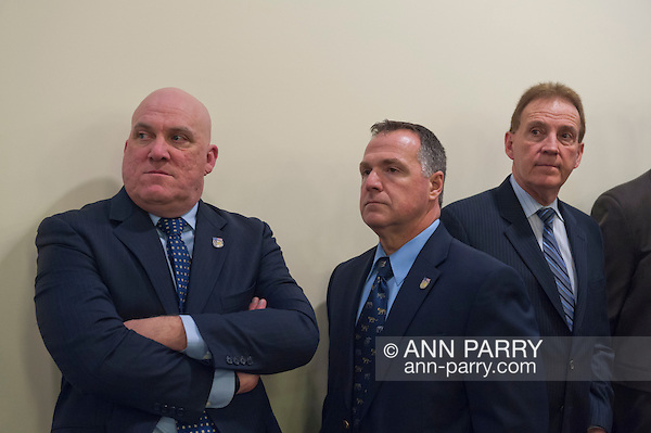 March 5, 2012 - Mineola, New York, U.S. - Event when Nassau County Legislature votes to confirm Thomas Dale as Police Commissioner and to consolidate 8 police precincts into 4. At left, Nassau PBA President JAMES CARVER, who spoke against closing precincts at the meeting, and at right, President of Superior Officers (SOA) GARY LEARNED. (Ann Parry/Ann Parry, ann-parry.com)