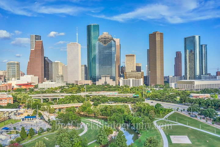This is a aerial view of the Houston Skyline with the Buffalo Bayou, Elenor Tinsley Park and the Jaimal Skate Park all in the image below. You can also see the Sabine St. Bridge along with the Allen Parkway and on the other side is Memorial dirve running along the other side of the park.  The city view includes the usual skyscrapers like the Chase Tower, Heritage Plaza, Wells Fargo, and the 1400 Smith St. buildings just to name a few.  You can see the Houston City Hall building at the base of the buildings where it is dwarfed by the high-rise skyscrapers since Houston has some ot the tallest buildings in the southern US. (Tod Grubbs)
