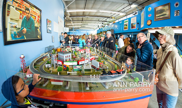 Farmingdale, New York, USA. November 26, 2016. At TMB Train Masters of Babylong Model Train Club's Open House, visitors look at actual train display - complete with blood stains - seen in 'The Blue Comet' episode of 'The Sopranos'. Photo above layout is scene with character Bobby Baccalieri at L.I. model train store. (Ann Parry/Ann Parry, ann-parry.com)