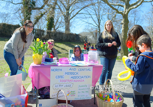 North Merrick, New York, USA. March 31, 2018. Sitting at table, LUCY MURPHY, member of American Legion Auxiliary Post 1282 and (right of her) SUE MOLLER, co-Pres. of NCMCA, and others are at Entrance table to Eggstravaganza at Fraser Park. (Ann Parry/Ann Parry, ann-parry.com)