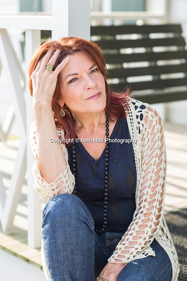 Rosanne Cash sits on the front porch of her father Johnny Cash's boyhood home on Saturday, August 16, 2014, in Dyess, Ark. The home was restored to it's appearance when the Cash family lived in it, from 1935-1954, and was part of The Dyess Colony that was created in 1934 as part of President Franklin D. Roosevelt's New Deal. Photo by Beth Hall (Beth Hall)