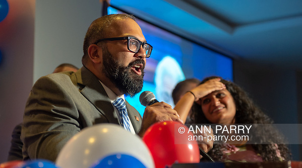 Garden City, New York, USA. November 6, 2018. Nassau County Democrats watch Election Day results at Garden City Hotel, Long Island. KEVIN THOMAS was elected New York State Senator for 6th District. His wife RINCY is standing next to him. (© 2018 Ann Parry/Ann-Parry.com)