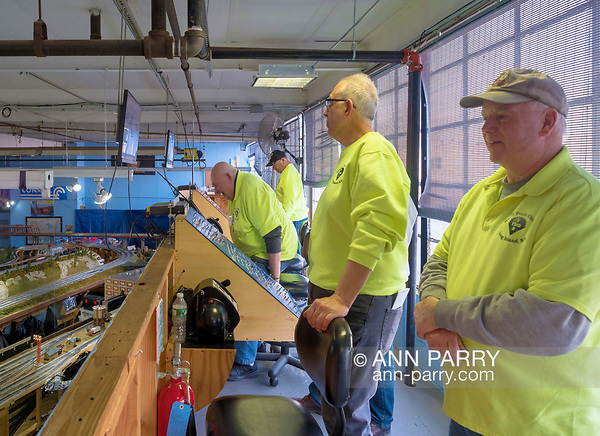 Farmingdale, New York, USA. January 21, 2018. DAVE WILLIAMS (far right) President of TMB Train Masters of Babylon Model Train Club and other members, are up in Controller Loft high above the train layouts during TMB Open House at its HQ. (Ann Parry/Ann Parry, ann-parry.com)