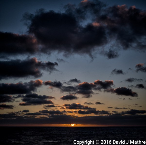Panorama of the sun rising over the Pacific Ocean from the aft deck of the MV World Odyssey. Composite of two images taken with a Fuji X-T1 camera and 35 mm f/1.4 lens (ISO 200, 35 mm, f/11, 1/250 sec). (David J Mathre)